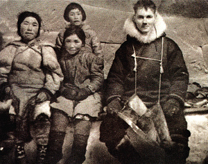 Maurice Strong with an Eskimo family